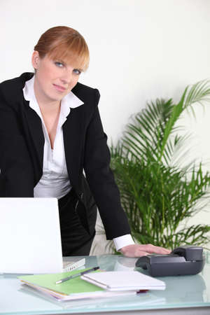 Businesswoman standing at her desk