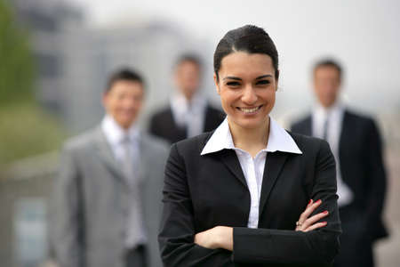 Business team lead by young brunette