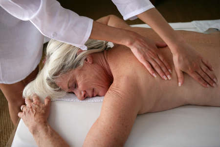 Photo for senior woman having a massage - Royalty Free Image