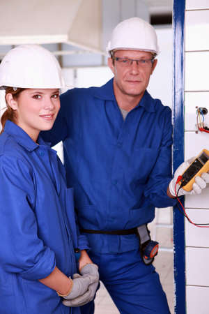 Young female apprentice electrician