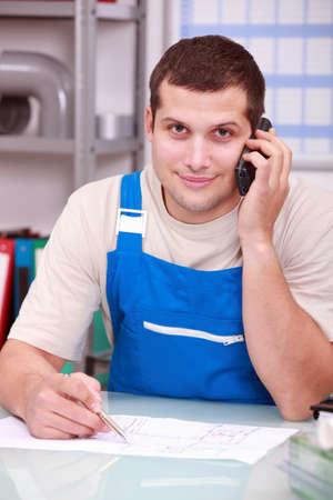 Technician on phone in office