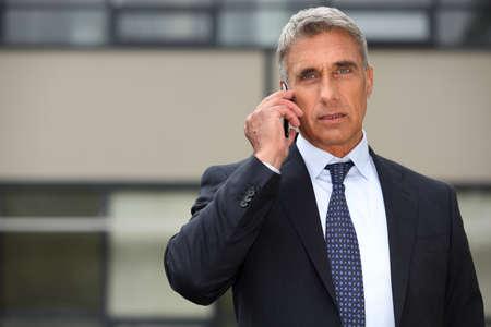 Mature businessman using a cell phone