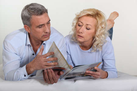 Couple looking at a catalogue