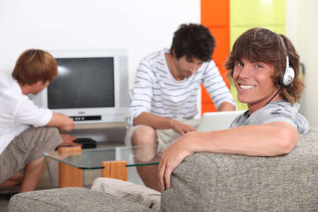 Three lads relaxing at home