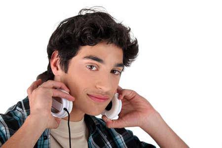 Boy putting headphones on