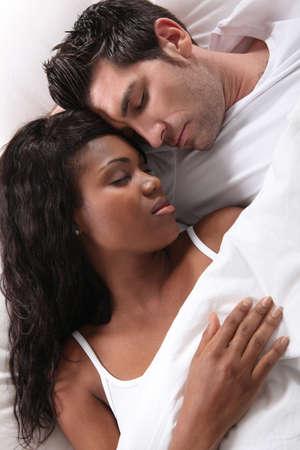 interracial couple sleeping