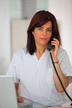 Medical secretary answering the telephone
