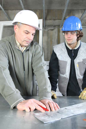 Electrician with young apprentice