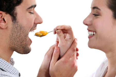 A woman feeding her man