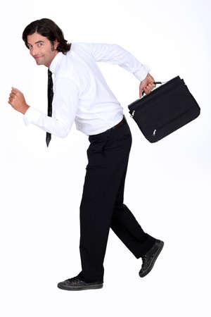 Businessman fleeing