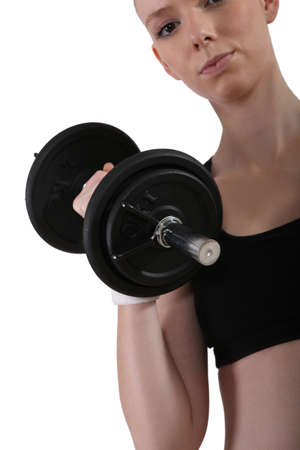 a young woman lifting a dumbbell
