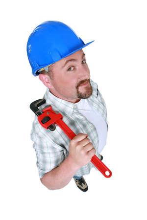 Photo pour Fat plumber holding tool - image libre de droit