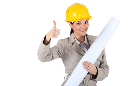 Cheery female architect giving the go-ahead