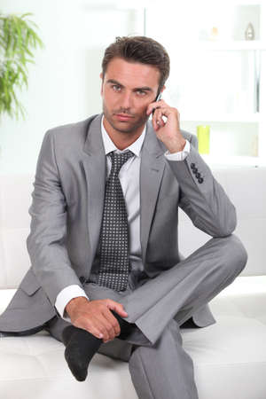 Man in a suit talking on cellphone