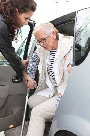 grandma with homehelper outdoors