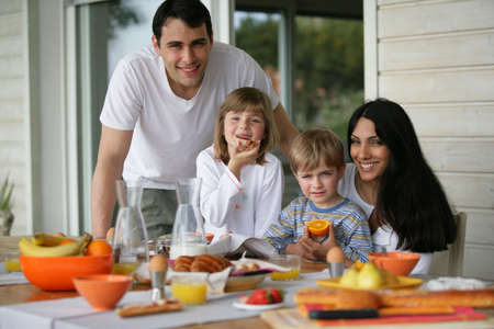 Photo for Family having breakfast outdoors - Royalty Free Image