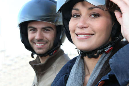 Couple with motorbike helmet