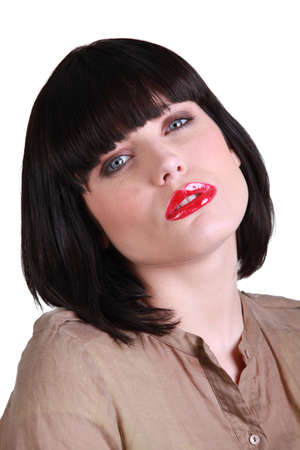 Woman with a smart bob and red lipstick