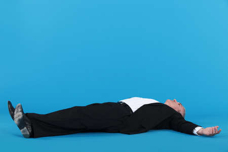 Businessman laying on floor