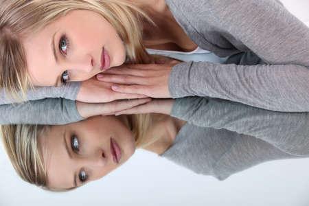 Photo pour Woman reflecting in mirror - image libre de droit