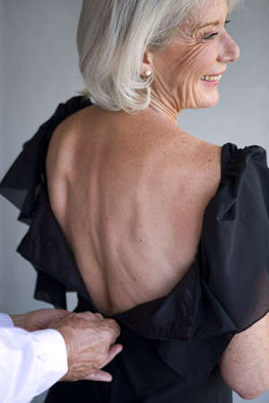Photo for Woman wearing a dress with a low back - Royalty Free Image