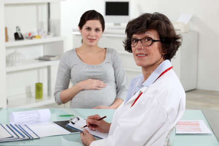 pregnant woman and in obstetrician's surgery