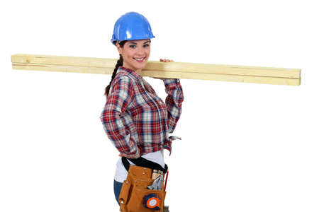 Photo pour Woman with strips of wood on her shoulder - image libre de droit