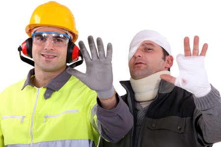 Photo pour Injured tradesman comparing his hand to a healthy colleague - image libre de droit