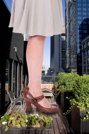 Giant woman in urban environment