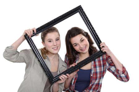 Photo pour Teen behind black frame - image libre de droit
