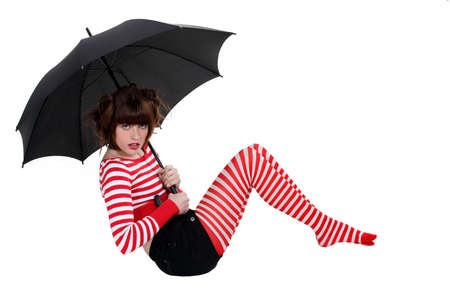 sexy woman in striped stockings holding umbrella