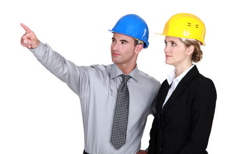 Photo pour An engineer pointing out a problem to his colleague - image libre de droit
