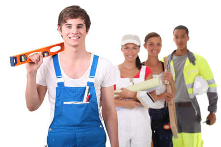 apprentice craftsman holding a level