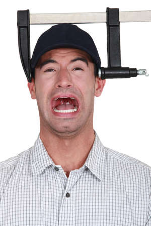 A man with a clamp on his head