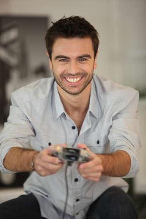 Smiling man playing games