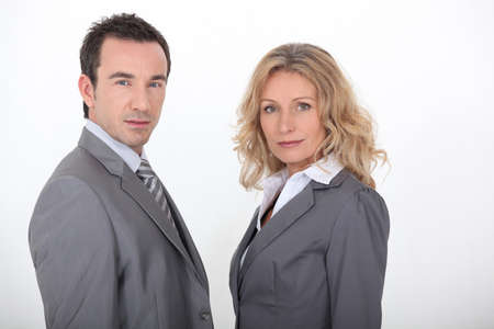 Couple in gray suit on white background
