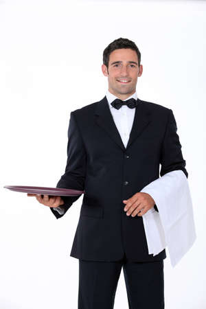 well dressed waiter facing the camera