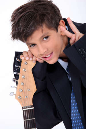 Boy posing with his electric guitar