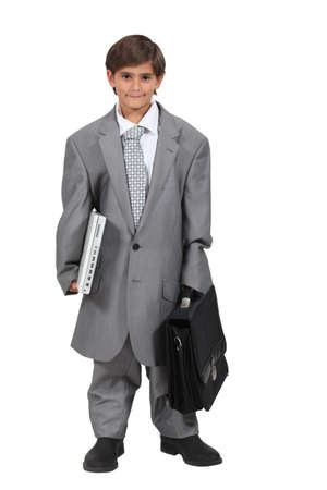 Boy dressed as a businessman