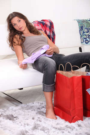 Woman examining her purchases