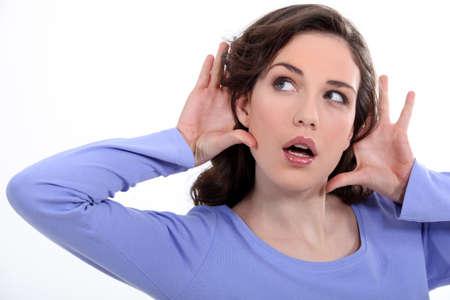 woman listening something carefully