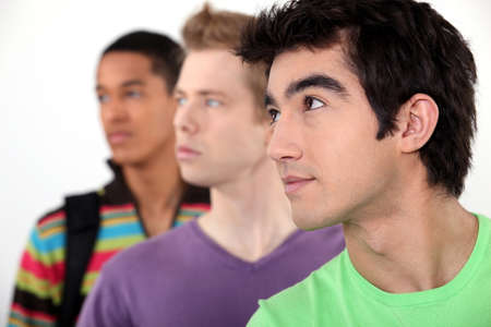 Three male student in line