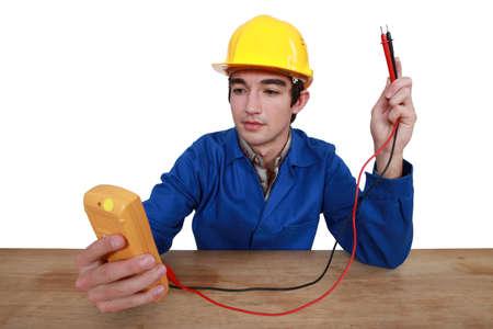 Tradesman using a multimeter