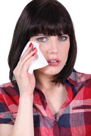 Woman wiping away a tear
