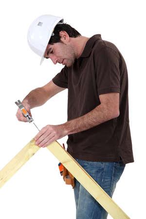 Photo pour Makin making wooden frame - image libre de droit