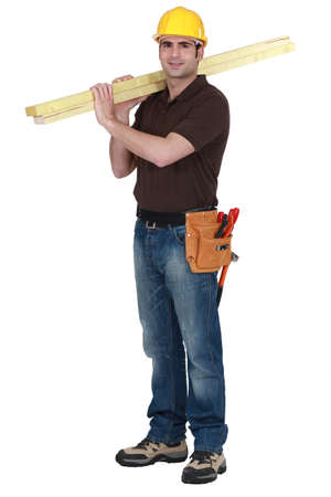 Builder carrying timber