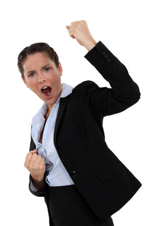successful businesswoman screaming and raising hands