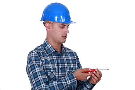 Laborer with screwdriver, studio shot