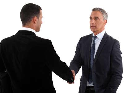 Photo pour A business handshake - image libre de droit