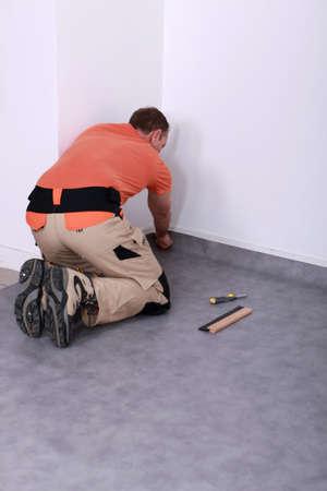 Men putting carpet